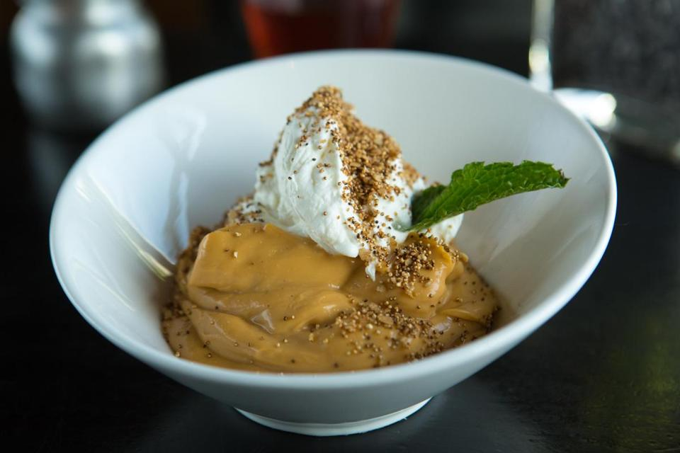 Butterscotch pudding topped with Chantilly cream.
